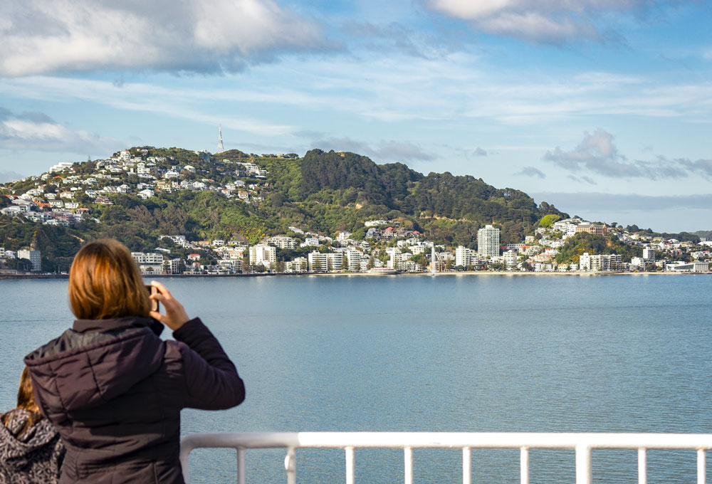 Taking pictures of Oriental Parade from the Interislander