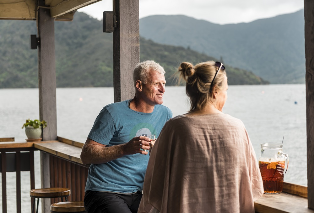 Punga Cove couple drinks Boatshed Cafe and Bar